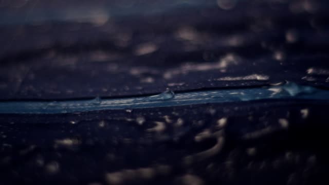 water drops on synthetic waterproof fabric. sports clothing zipper close up - raincoat stock videos & royalty-free footage