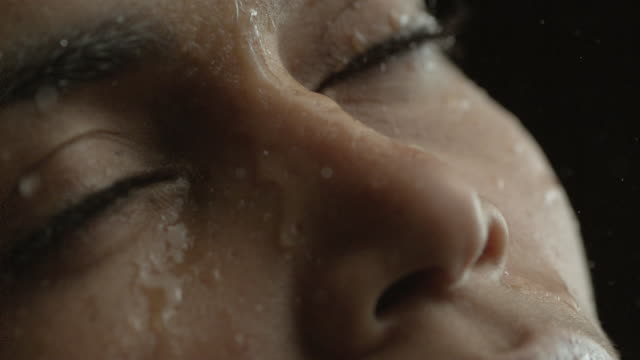 Water drops on woman's face.