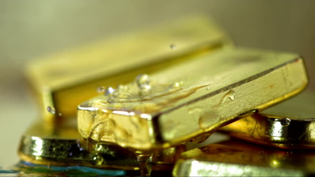 water drops splashing on gold (super slow motion) - ingot stock videos and b-roll footage