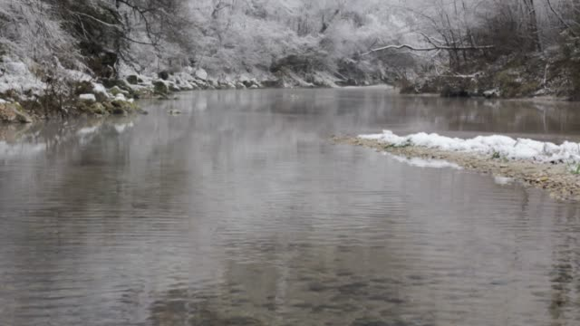 water evaporates from the river in winter with frosty trees - evaporation stock videos & royalty-free footage