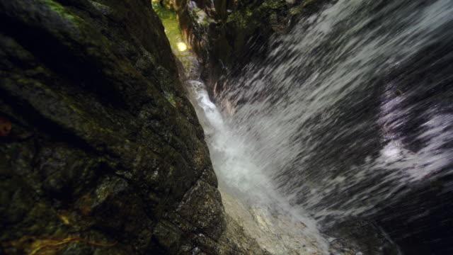 water falling from crack of rock cliffs in uljin geumgang pine forest / uljin-gun, gyeongsangbuk-do, south korea - ravine stock videos & royalty-free footage