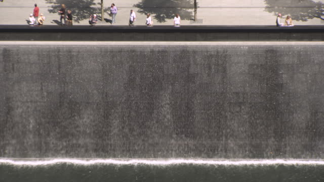 water falls into part of the national september 11 memorial, 'reflecting absence', in manhattan, new york city, usa. - september 11 2001 attacks stock videos & royalty-free footage
