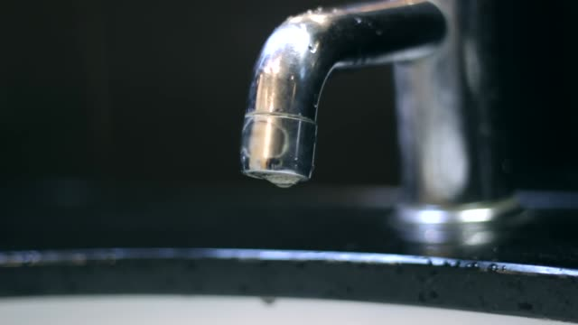 water faucet being turned on and off waste the resources - tap stock videos & royalty-free footage