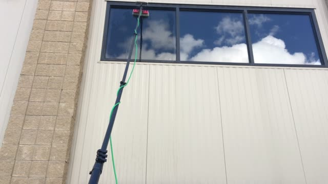water fed pole for window cleaning - pole stock videos & royalty-free footage