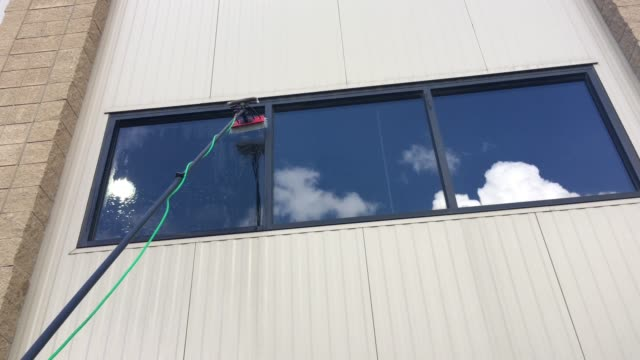 water fed pole for window cleaning - window washer stock videos & royalty-free footage