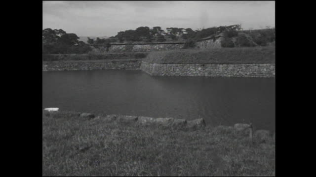 a water filled moat surrounds the fortress in goryokaku park. - moat stock videos & royalty-free footage