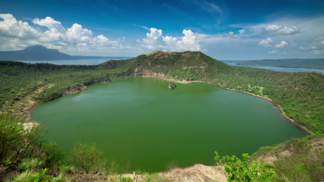 water filled volcano caldera surrounded by lake - time lapse - batangas province stock videos and b-roll footage