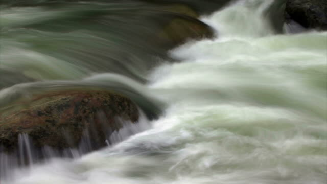 water floats down a rocky river. - digital enhancement stock videos & royalty-free footage