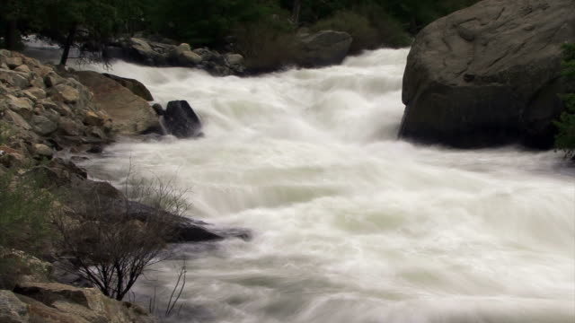 water floats down a rocky river. - miglioramento digitale video stock e b–roll