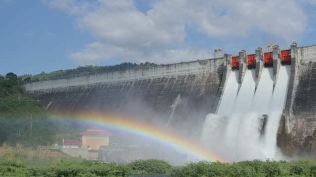 Water flow from the dam and rainbow.