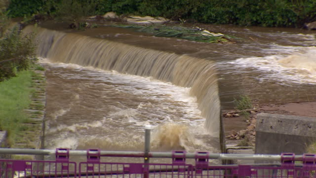 water flowing at the damaged toddbrook reservoir - dam stock videos & royalty-free footage