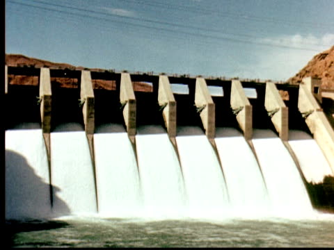 1960 montage water flowing down spillway at hydroelectric power plant / pakistan - hydroelectric power stock videos & royalty-free footage