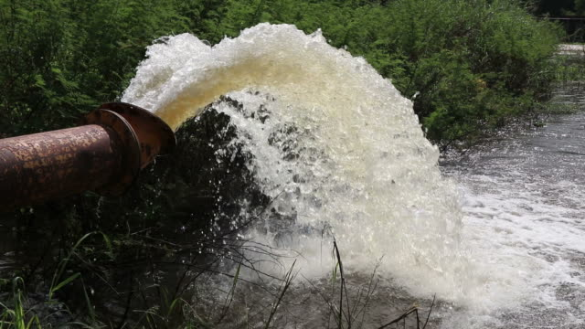 Water flowing from a large pipe.