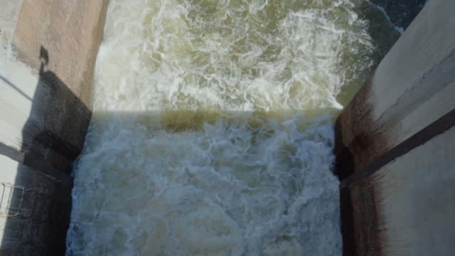 water flowing from dam,slow motion - hydroelectric power stock videos & royalty-free footage
