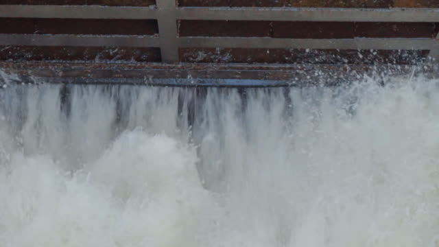 water flowing from dam,slow motion - flowing stock videos & royalty-free footage
