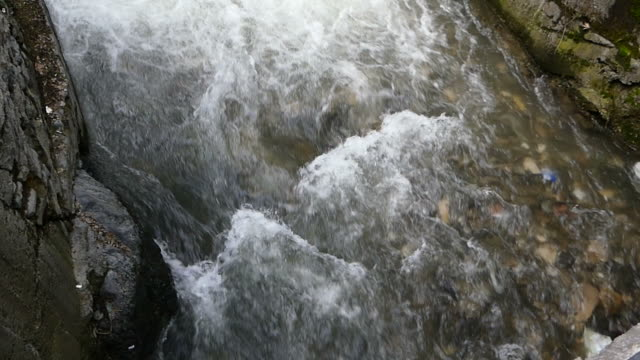 water flowing from the mountain to form a small canel - nightdress stock videos & royalty-free footage