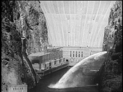 b/w 1936 water flowing from valves of hoover dam / nevada / newsreel - hoover dam stock videos and b-roll footage
