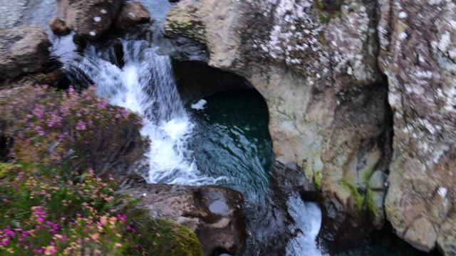 water flowing in the beautiful fairy pools in the isle of skye in scotland. - insel skye stock-videos und b-roll-filmmaterial
