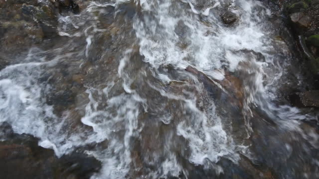 vidéos et rushes de ms water flowing over rocks in river / sundance, provo river, utah, usa - provo