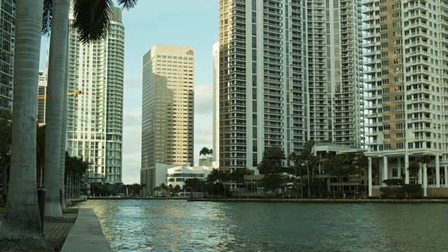 water flowing past hotels on brickell key, miami - miami dade county stock videos & royalty-free footage