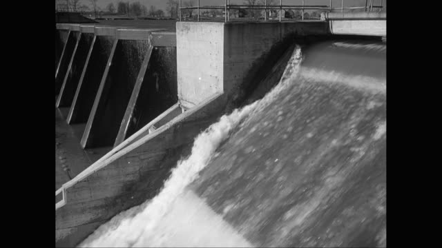 ws water flowing through dam / united states - dam stock videos & royalty-free footage