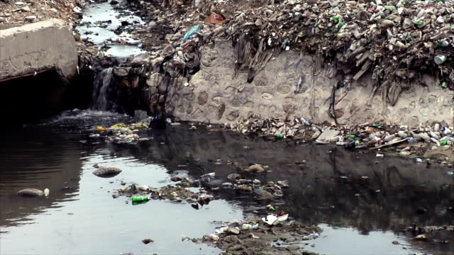 Water Flowing Through Garbage Dump