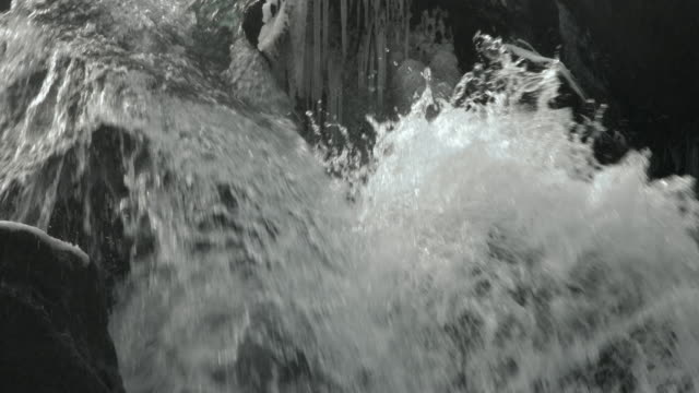 Water flows down a small waterfall.