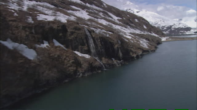water flows down rock formations as snow melts in prince william sound. - prince william sound stock videos and b-roll footage