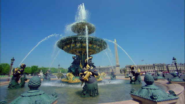 Water flows from the Fountain of River Commerce and Navigation in Paris, France.
