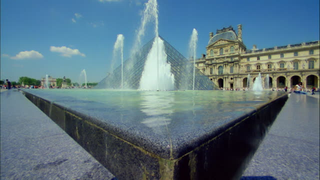 Water flows in a fountain at the Louvre in Paris, France.