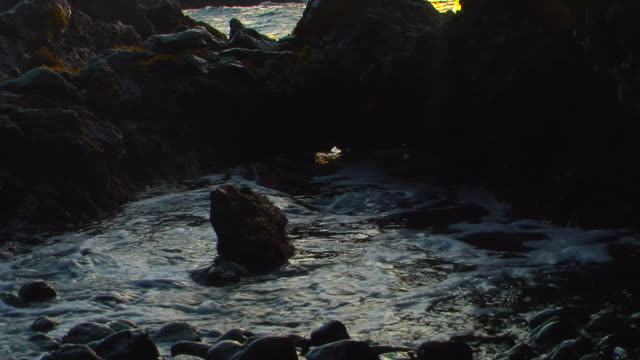 water flows into a rocky inlet. available in hd. - inlet stock videos & royalty-free footage