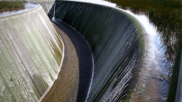 Water flows into Watercare's Lower Nihotupu Dam in the Waitakere Ranges on August 17 2017 in Auckland New Zealand There are five dams in the...