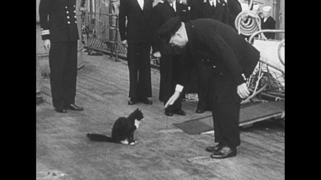 stockvideo's en b-roll-footage met water flows over deck of hms prince of wales / british prime minister winston churchill walks on deck of ship with lord beaverbrook as he travels to... - geallieerde mogendheden