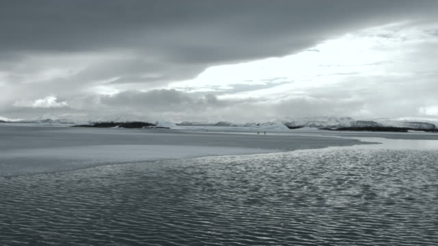 Water flows through a frozen landscape at the Snaefellsnes peninsula in Iceland.