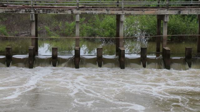 Water flows through dam spillways.