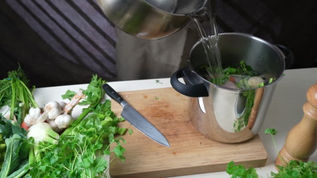 water for cooking chicken and preparing broth - broth stock videos & royalty-free footage