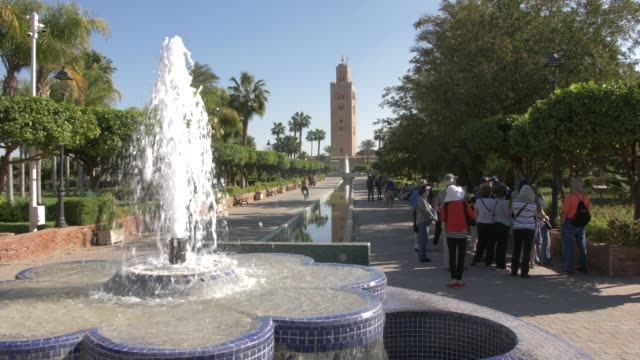 water fountain and koutoubia minaret, marrakech, morocco, north africa, africa - minaret stock videos & royalty-free footage