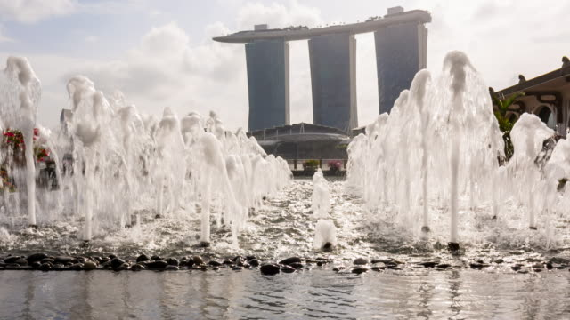 cu water fountain and singapore skyline - marina bay sands stock videos and b-roll footage