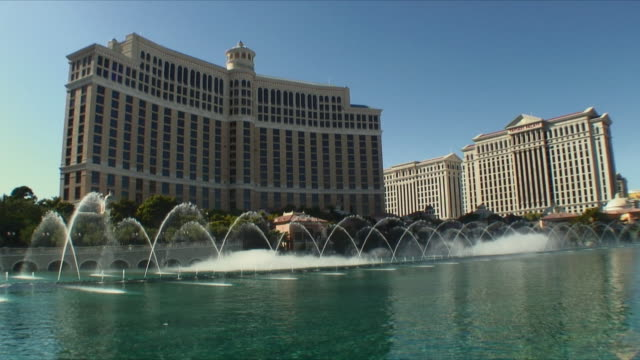 ws water fountains in front of bellagio hotel / las vegas, nevada, usa - caesars palace las vegas stock videos & royalty-free footage