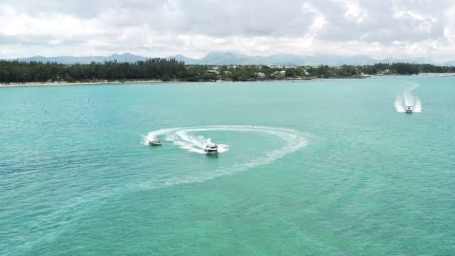 water games in mauritius - speed boat stock videos & royalty-free footage