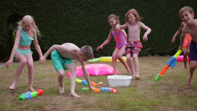 water gun fight! - water fight stock videos & royalty-free footage