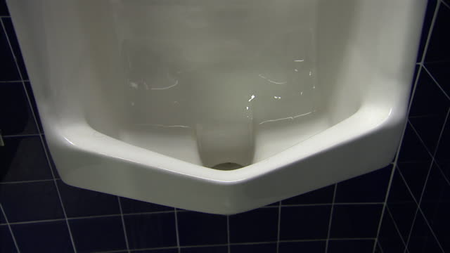 water gurgles in a public urinal. - urinal stock videos & royalty-free footage