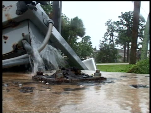 water gushes from broken water main, fort pierce, florida; 4 sep 2004 - pipe stock videos & royalty-free footage