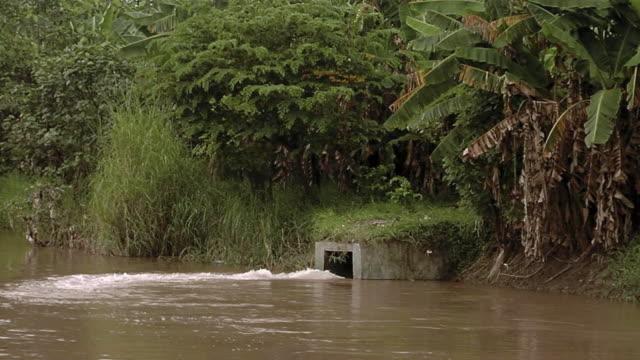 ms water gushes into river / surabaya,east java,indonesia - surabaya stock videos & royalty-free footage