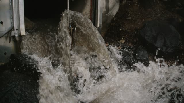 water gushes out of a canal pipe - concrete stock videos & royalty-free footage