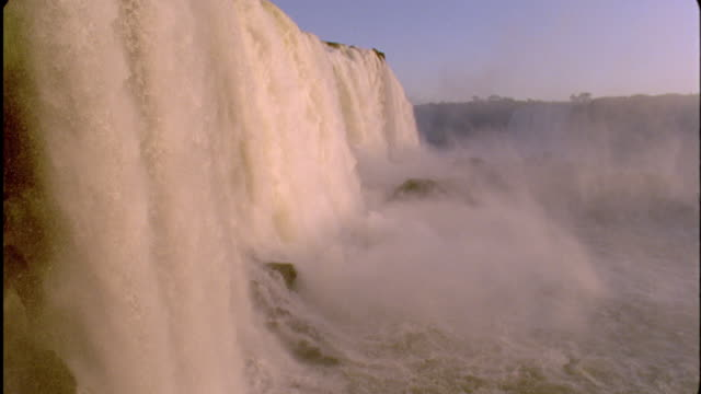 Water gushes over Iguazu Falls, South America Available in HD.