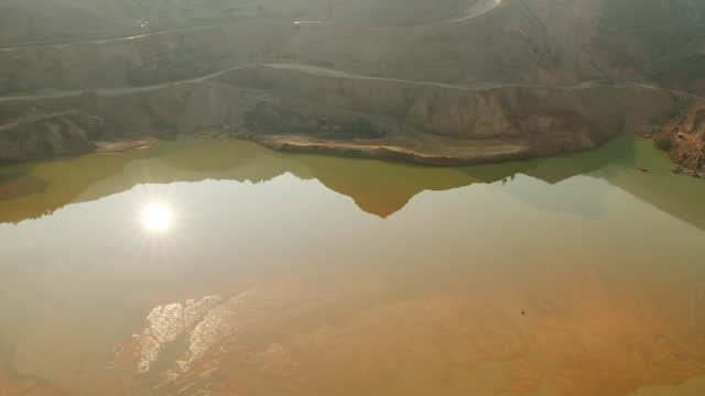 water in or next to a gold mine, drc - helicopter point of view stock videos & royalty-free footage