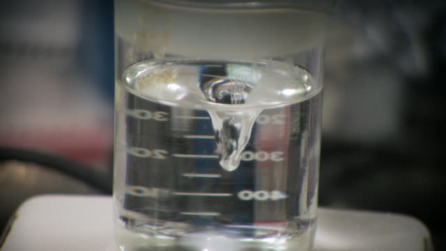 cu water in spiral using magnetic stirrer / toronto, ontario, canada   - becher video stock e b–roll
