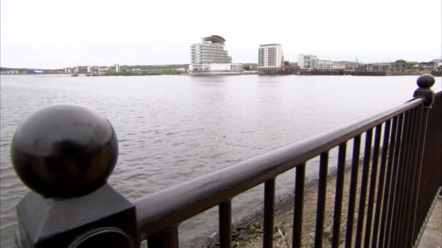 water laps the shore of cardiff bay. available in hd. - cardiff wales stock videos & royalty-free footage
