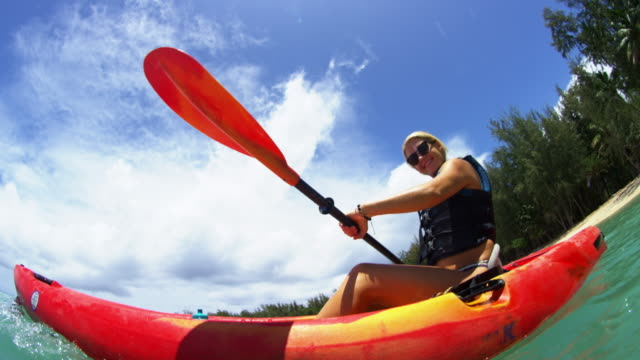 water level shot of kayaker looking at camera smiling - kayak stock videos & royalty-free footage